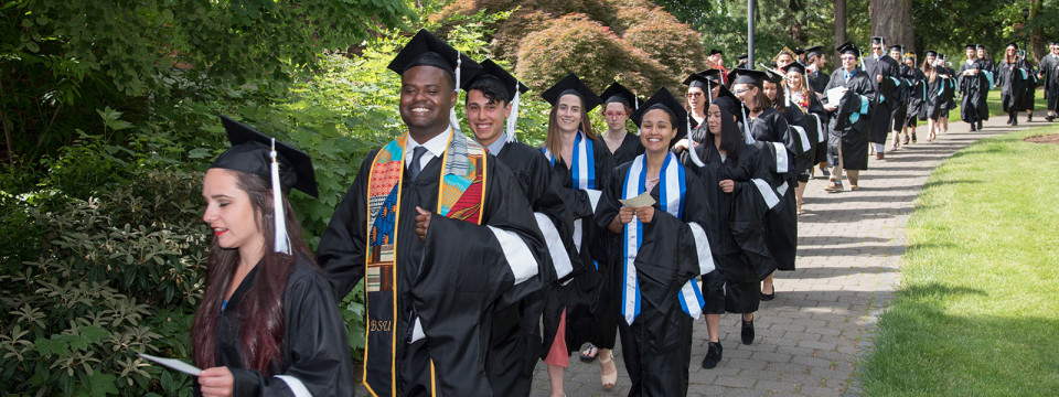 Graduates walk in the 2018 commencement ceremony at Lewis & Clark.