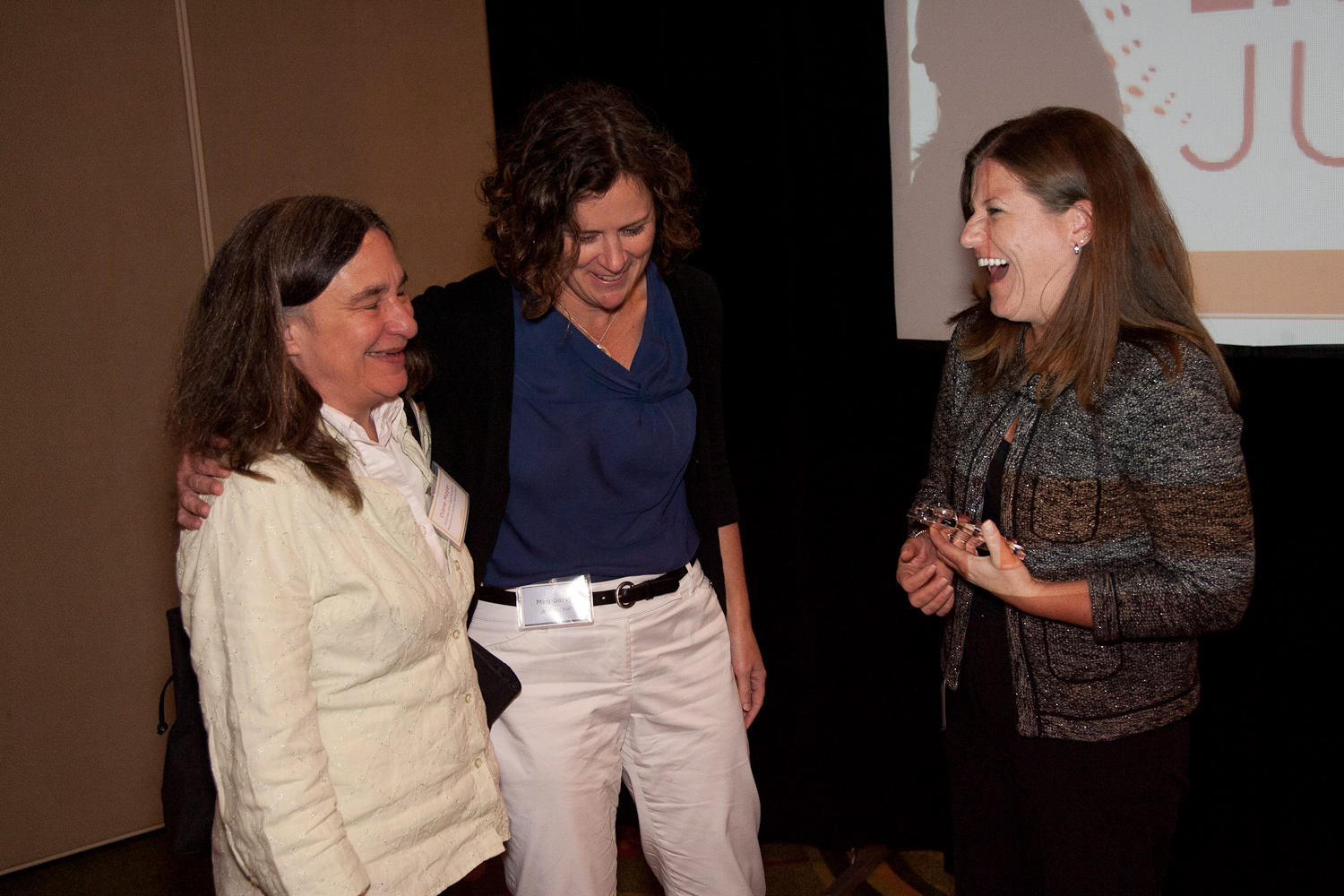 Meg Garvin laughs with NCVLI Board Member Diane Moyer and recipient of the 2012 Gail Burns-Smith ...