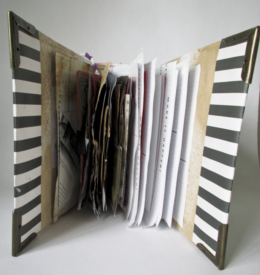 Title: Grief Junk Journal, openDimensions: 3.5x8.3x7.5Materials: Cardboard, fabric, magazine cuto...